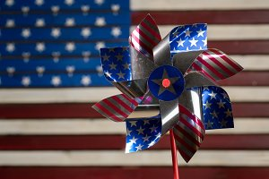 Pinwheel or whirligig in front of US flag