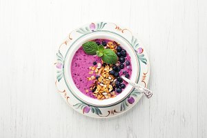 Smoothie bowl with granola and berries.