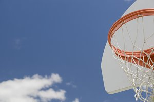 Abstract of Community Basketball Hoop and Net Against Blue Sky.