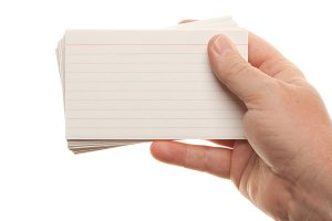 Male Hand Holding Stack of Flash Cards Isolated on a White Background.