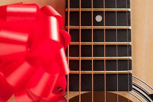 Guitar Strings with Red Ribbon - The Gift of Music.