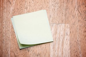 Post It Notes on Wood Background