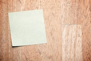 Post It Note on Wood Background