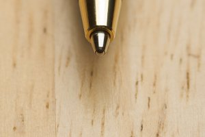Ball Point Pen Macro on Wood Background with Narrow Depth of Field