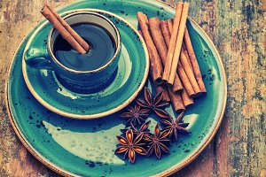 Cup of black coffee with spices