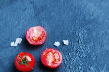 Red sweet tomatoes on the table