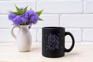 Black coffee mug mockup with blue