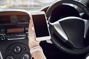 women hoding smartphone on the car in travel trip. vacation time.
