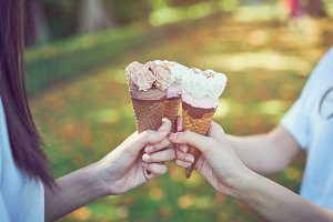 Women hand holding an ice cream