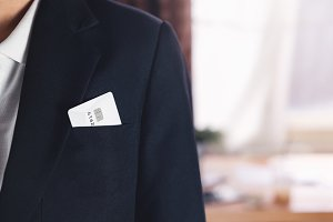 Credit card in pocket businessman black suit in the office.