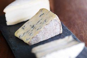 gourmet cheese on slate board