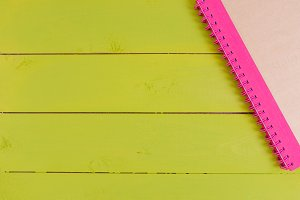 Notebook paper with on wooden background.