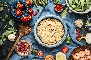 Cooked quinoa and salad ingredients