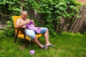 Young man knitting