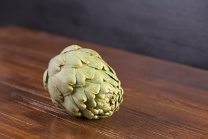 Artichoke on brown wood