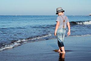 the boy plays near the sea. lifestyl