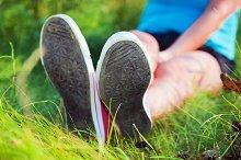 Sneakers on girl legs