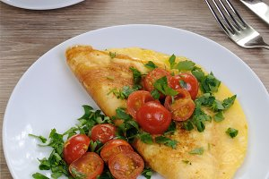 Omelette with tomatoes and herbs