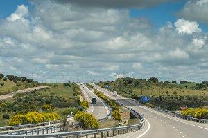 Almost empty highway road in rural mountain landscape in Spain