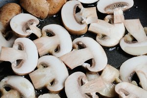 Sliced mushrooms fried in oil