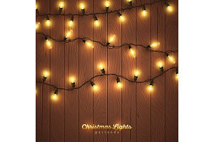 Yellow christmas lights on wooden background