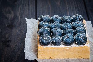 Lemon Tart and tartlets with fresh blueberries