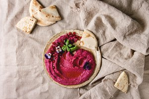 Beetroot hummus spread with nuts
