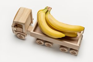 Toy truck dump with bananas.