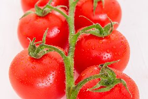 Bunch of fresh organic tomatoes isolated on white background