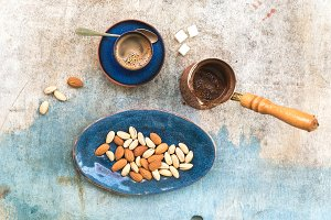 Black coffee with almonds and pistachios