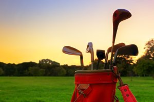 Golf equipment at sunset