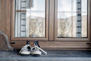Sneakers on window sill