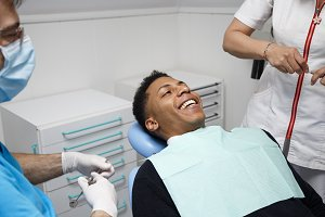 Cheerful man during visit to dentist