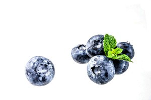 Raw berries on white background