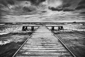 Wooden jetty during storm on the sea