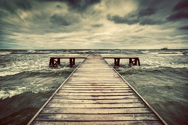 Wodden jetty during storm on the se…