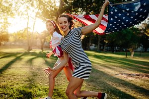 Female friend running with American