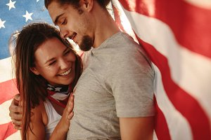 Couple in love under American flag