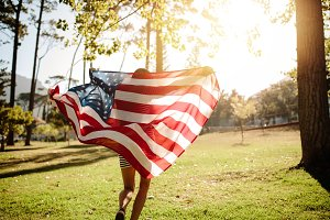 Woman running with american flag