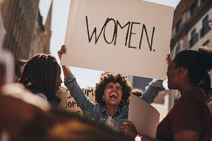 Group of female demonstrating