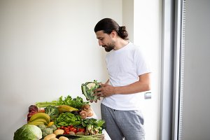 Man holding a fresh cauliflower
