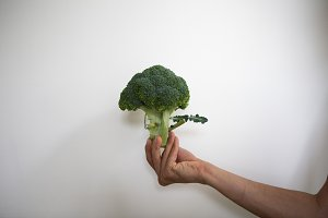 Male hand holding broccoli