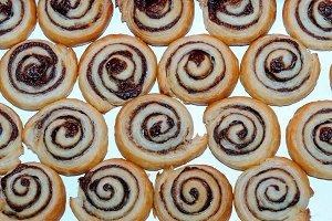 Cinnamon rolls, snail cake on white