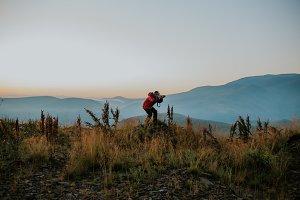 Man traveler taking photo
