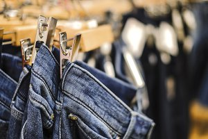 Row of hanged blue jeans pants