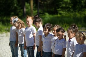 Group of little children in white t
