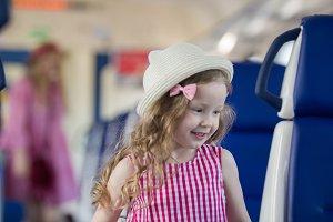 Cute blonde little girl runs away