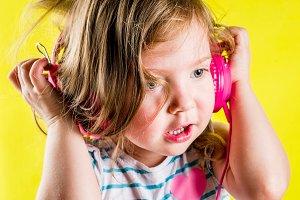 Сute toddler girl with headphones