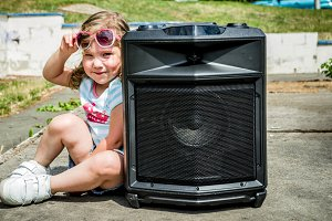 Cute girl with portable speaker