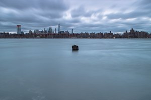 View of manhattan from rocky beach